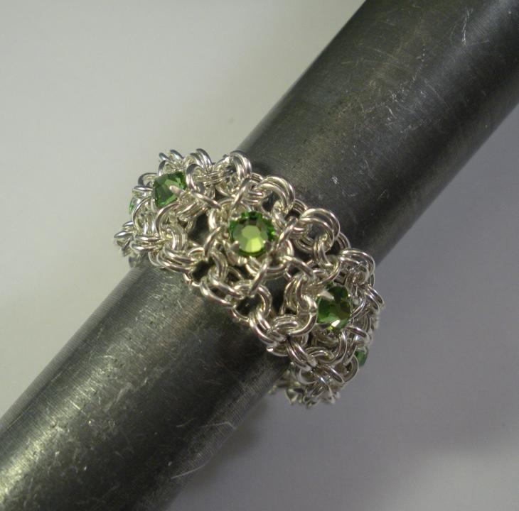 Chain Maille Ribbon Eternity Ring in Peridot Green Swarovski Crystal
